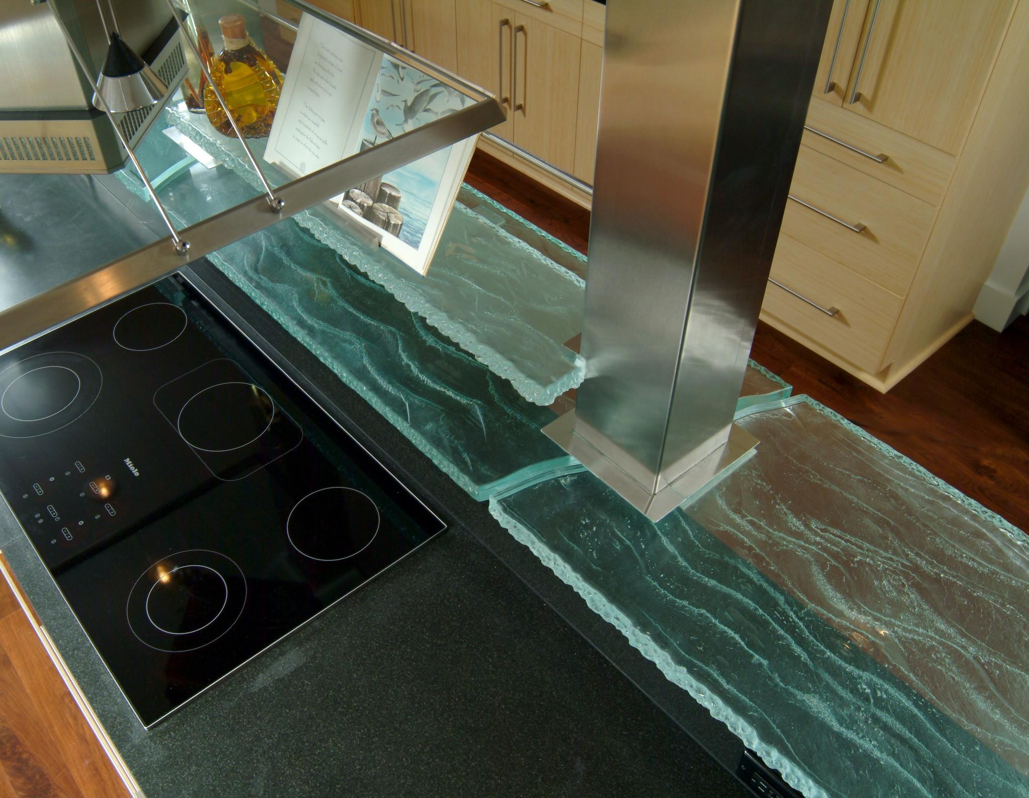 contemporary coastal kitchen design detail. Custom design glass shelf around columns over cooktop