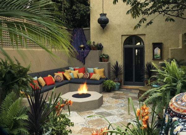 mediterranean patio with fire pit and L seating couch
