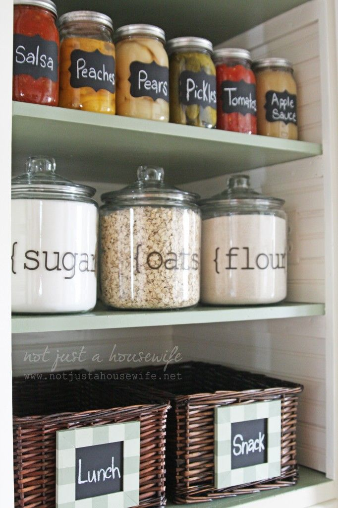 organized pnatry shelves with dry food ingredients in glass jar containers with labels