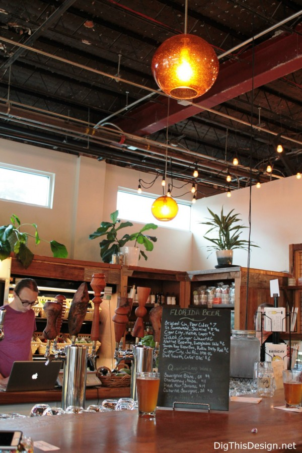 Local Roots wood bar and glass pendant lights at East End Market