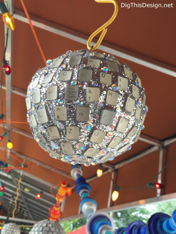 Satchel's upcycled keyboard keys into disco ball junk art