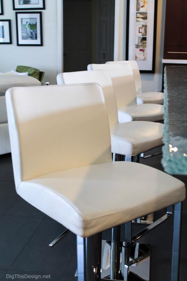 A row of modern white leather bar stools with chrome base after being cleaned