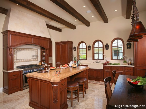old world traditional kitchen interior design with wood cabinets island and exposed rafters