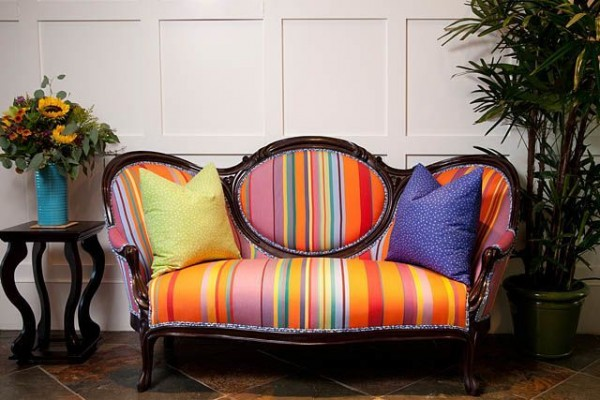 Colorful stripped upholstered Victorian couch by Darci Good Design.