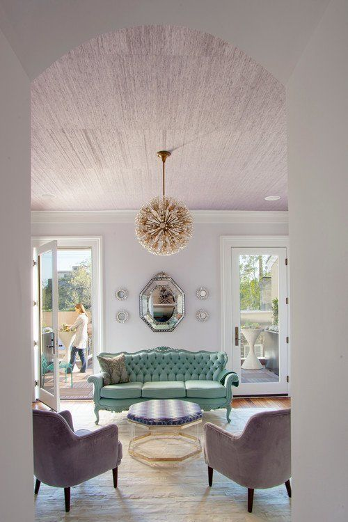 Contemporary living room interior design by Rethink Design Studio with victorian antique furniture.