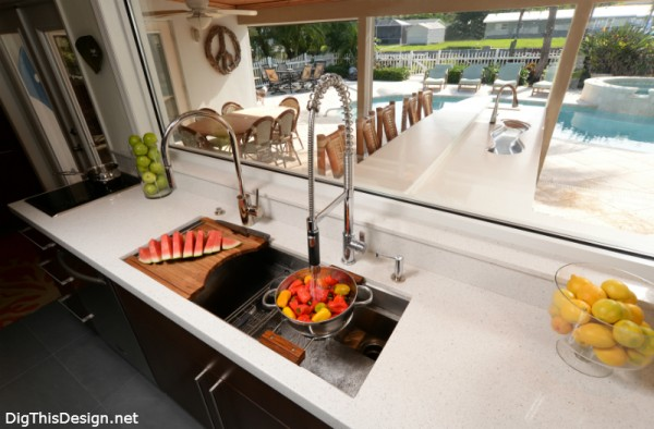 Kallista chef sink with accessories in a modern coastal kitchen with large window view