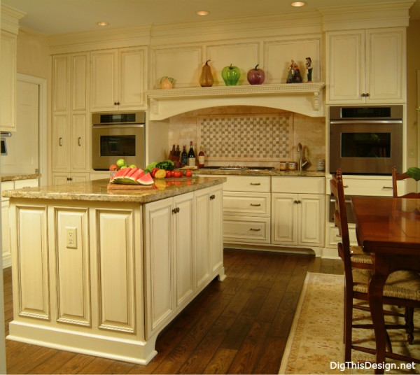 kitchen cooking zone design with hood and range in traditional old world style
