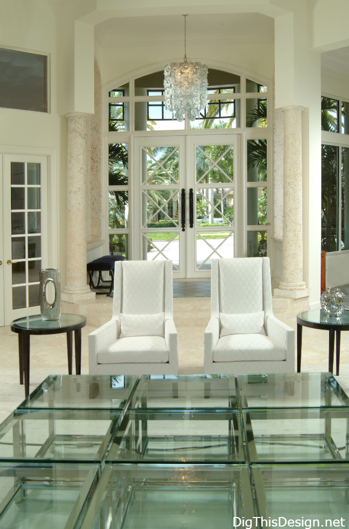coastal luxury home entry foyer with white furniture and glass decor