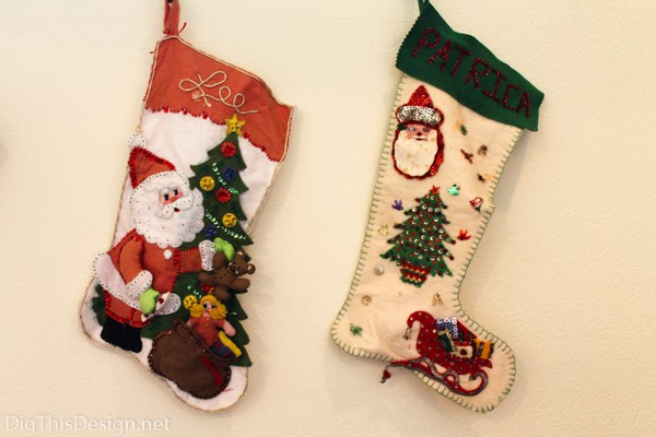 Handmade DIY family heirloom Christmas stockings hanging from windowsill as holiday decor