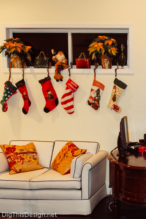 Windowsill holiday decor with Christmas ornaments and stockings