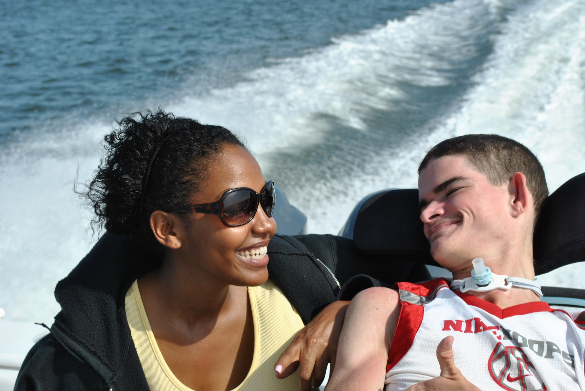 Wheelchair bound young man enjoying a boat ride.