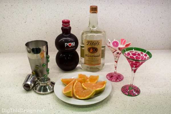 Ingredients for healthy vodka cocktail for Valentine's Day. Pomegranate juice, fresh grapefruit, tito's vodka, martini glasses