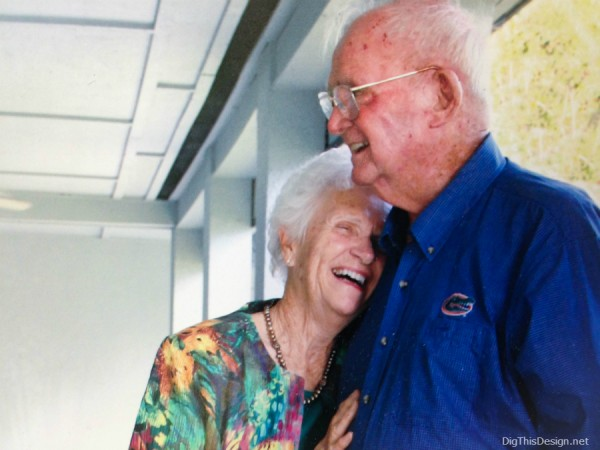 Picture of a loving elderly couple laughing.