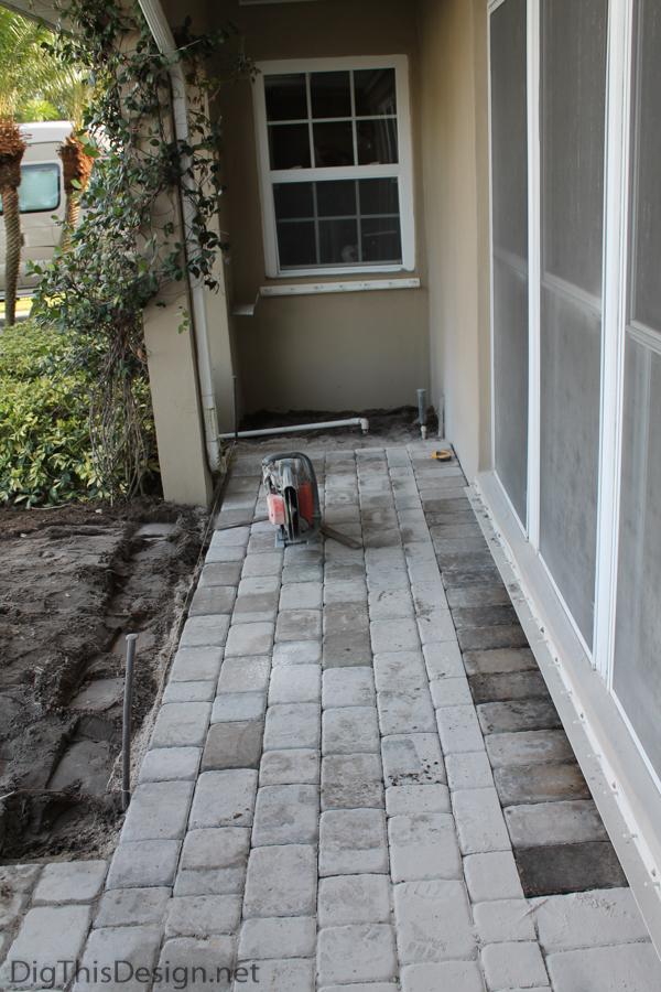 Adding a new paver porch.