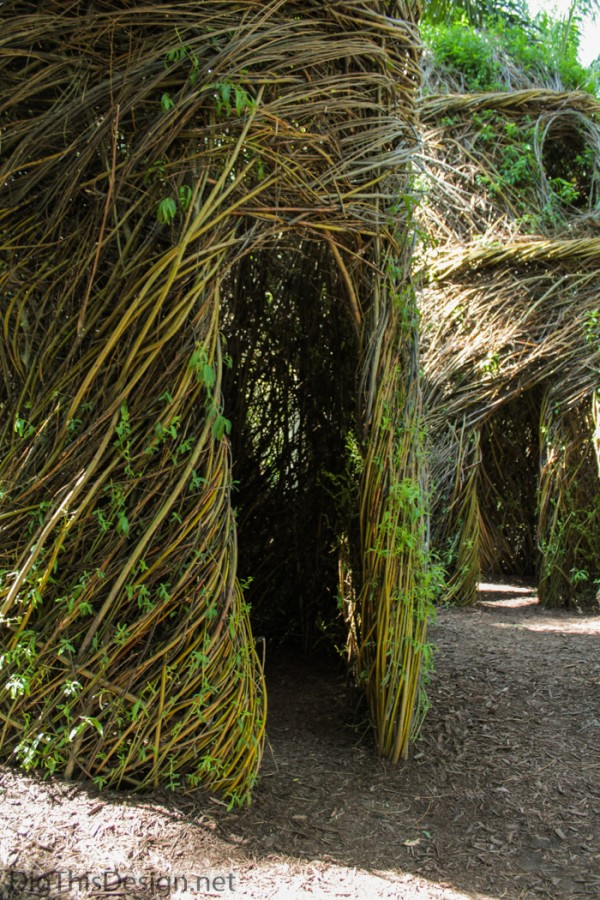 Doorway to garden sculpture hut made of tree branches and saplings by artist Patrick Dougherty.