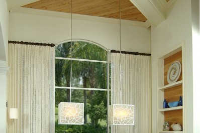 Large cube shaped chandeliers hanging in a dining room. Design by Patricia Davis Brown Designs, llc.