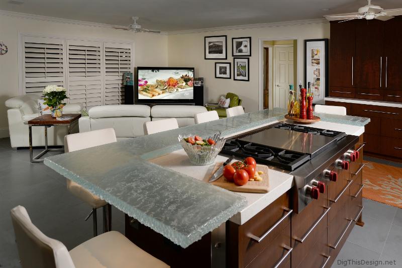Glass countertop around island in a contemporary coastal kitchen.