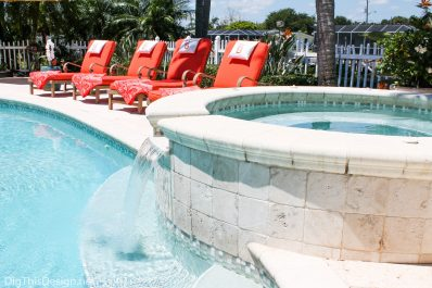 Orange chaise lounges around pool.