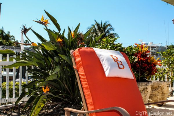 Orange monograming on head pillows.