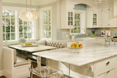 Kitchen Remodel - White kitchen with blue tile backsplash and banquette seating