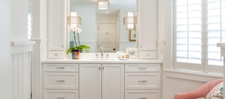 A bathroom transformation with pops of colors against a neutral background.