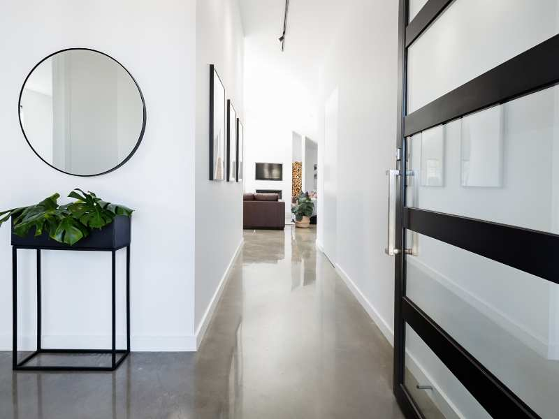 Foyers; contemporary entry way with polished concrete floors