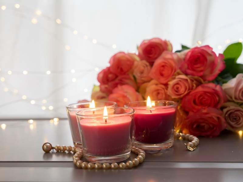Romantic scented red candles and roses for valentine decor