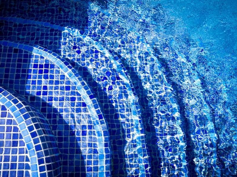 Pool remodeling with glow in the dark tiles