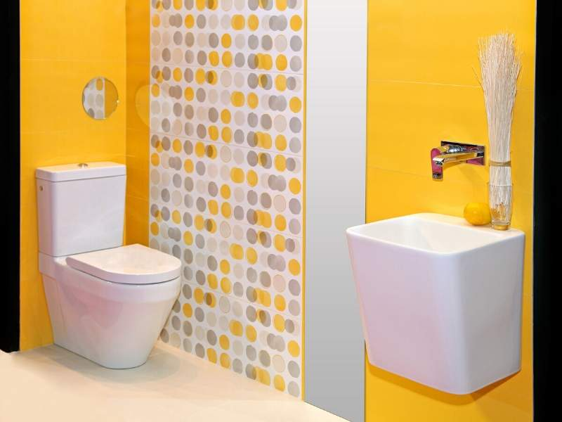 Powder Room in Yellow and White with Pops of Grey