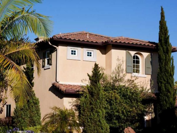 Southwest Style Wood Shutters on Stucco