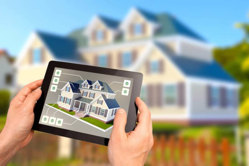 Sustainable housing smart home automation tablet controls with house in background