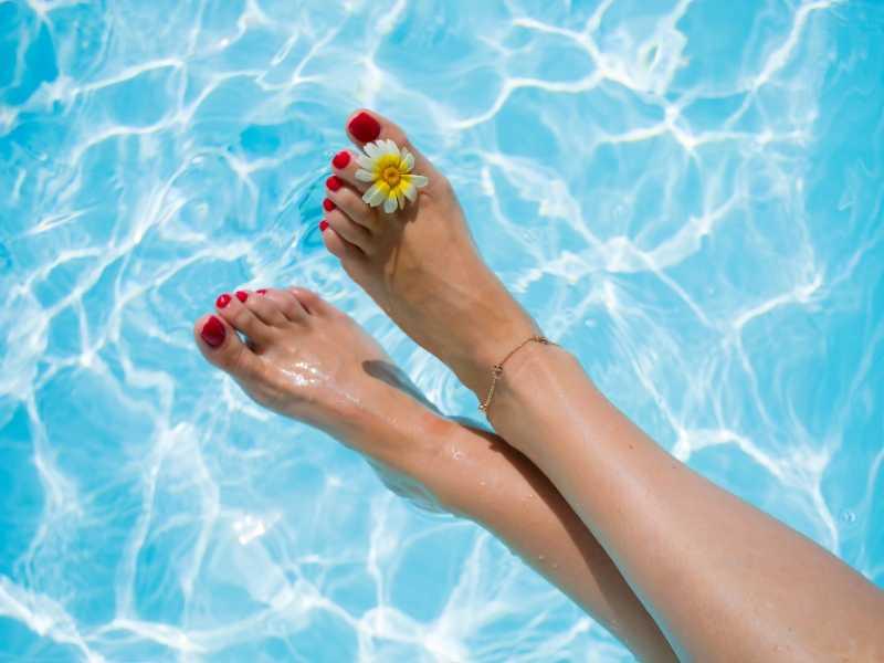 Beautiful feet over pool