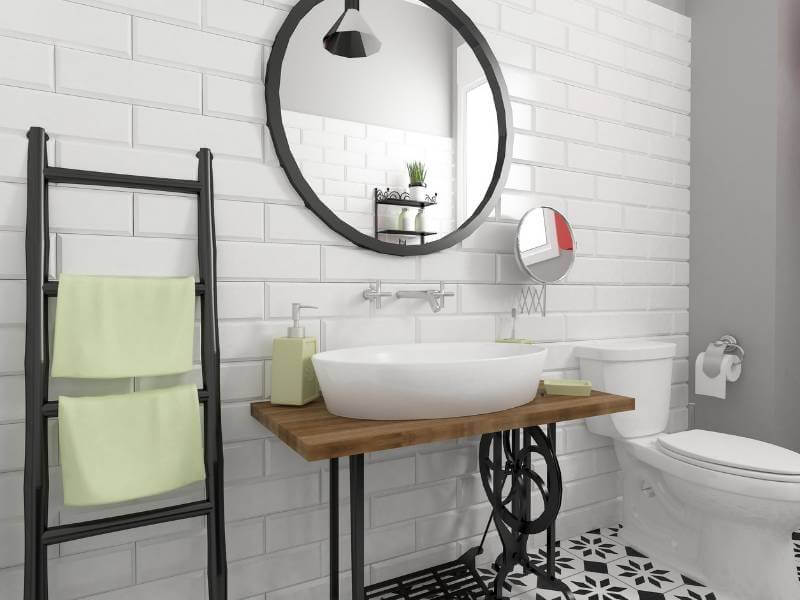 Bathroom with white brick wall and subtle pops of summer green