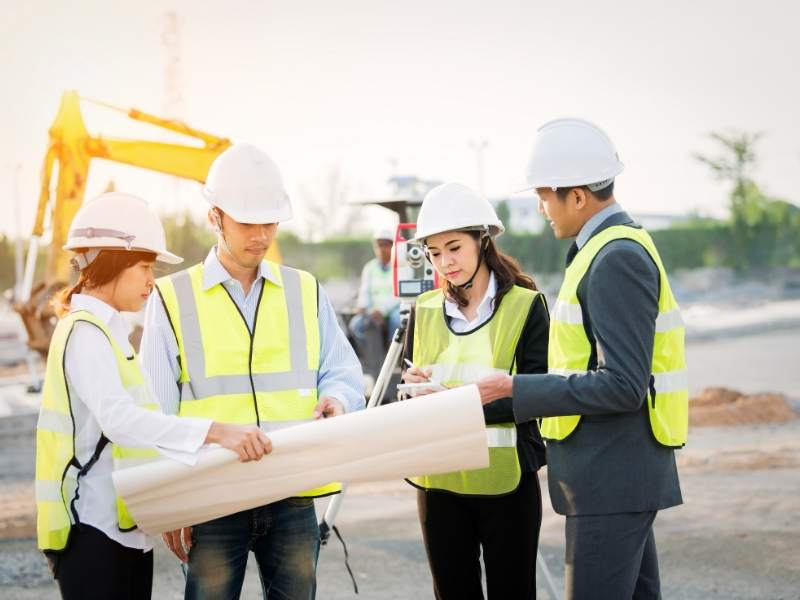 Quality Surveyor works with construction team