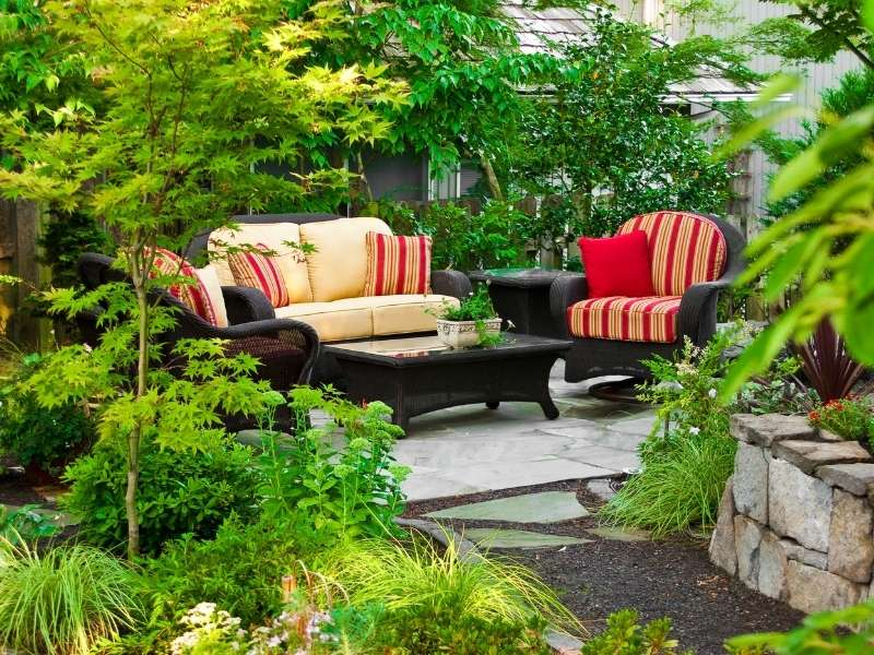 The Relaxing and Surprising Benefits of Owning Garden Furniture - Outdoor rattan furniture on wooden deck