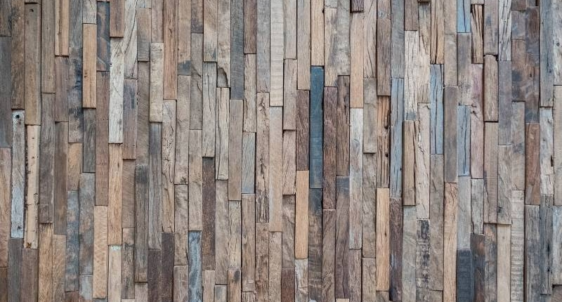 12 Unique Ways to Bring Reclaimed Wood into Your Home - vertical pattern of reclaimed wood for walls. Uses narrow pieces for a modern rustic look.
