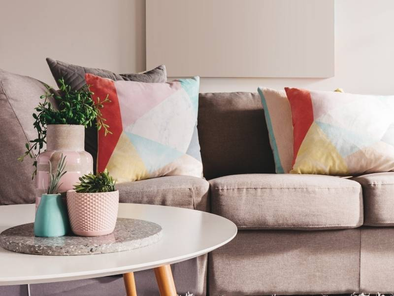 How To Add Color to Your Living Room - bring in colorful cushions