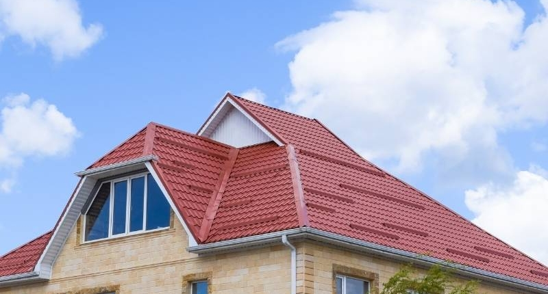 Material Options for Residential Roofs - Home with Red Metal Roof