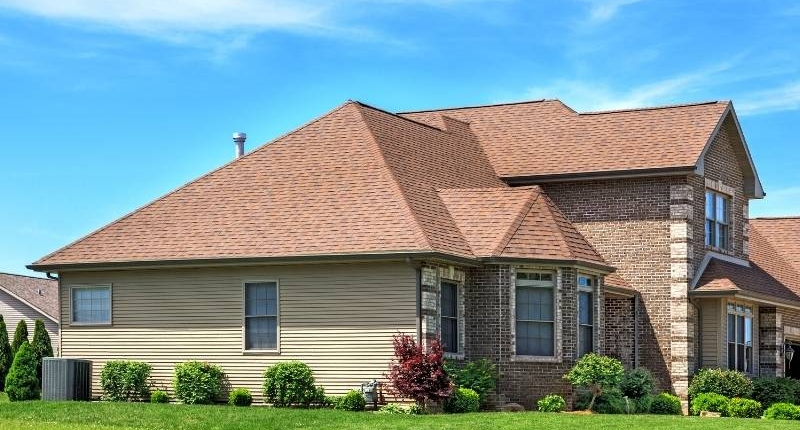 Material Options for Residential Roofs - Home with asphalt roof.