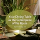 Designing Your Dining Table to be the Centerpiece of the Room - Natural texture setting with bulbs sprouting in a low bowl with green glass ware and earthy table settings.