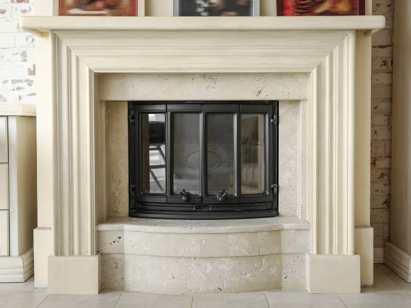 How to Clean Your Fireplace Glass Door and Get Rid of Sticky Soot - White Deco Style Fireplace with Clean Glass Doors.