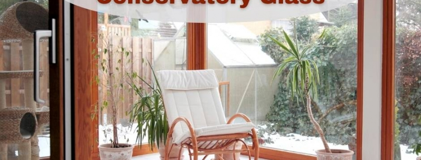 Selecting the Right Conservatory Glass - image of conservatory with glass walls, white floors, and a bentwood rocker.