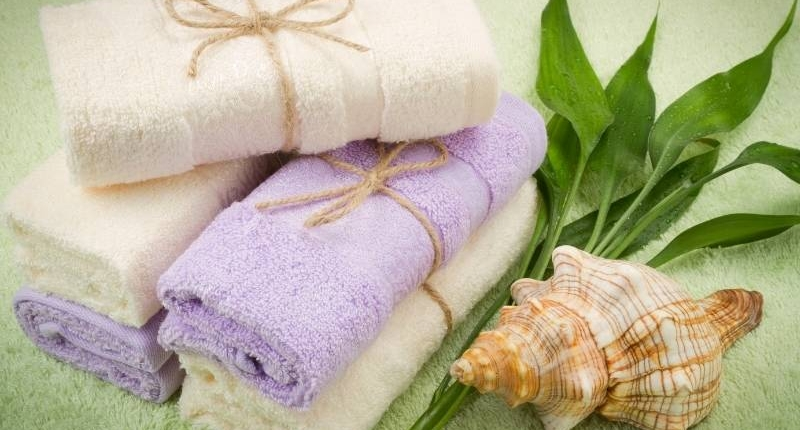 Modern uses of bamboo material seen here is white and lavender bamboo bath towels.