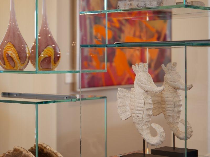 3 Luxurious Decor Ideas for an Empty Wall - Glass Shelving