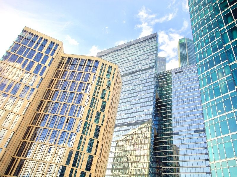 The How-To and the Benefits of Investing in REITs - Photo of Tall Commercial buildings