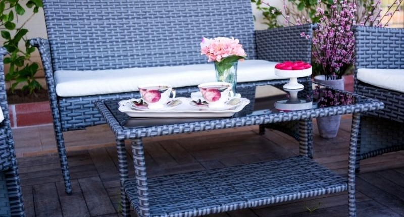 How To Create A Summer-Ready Patio - Blue rattan patio furniture with a lovely china tea set.