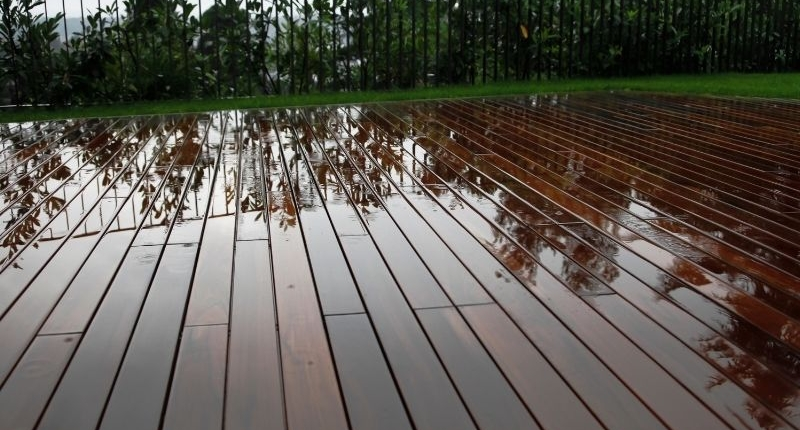 How To Create A Summer-Ready Patio - a clean wet wooden patio recently washed.