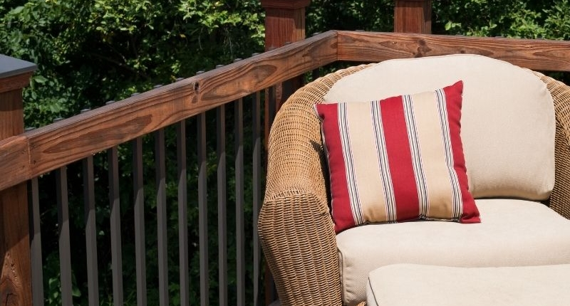 How To Create A Summer-Ready Patio - Earthy yet bright cushions on rattan and linen patio furniture.