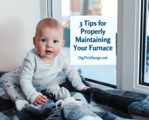 3 Tips for Properly Maintaining Your Furnace - baby sitting by winter window on blue and grey plaid blankets.