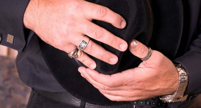 Man wearing multiple rings for how to style your rings for the holidays